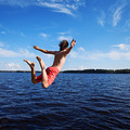 Young man jumping into water, summer time